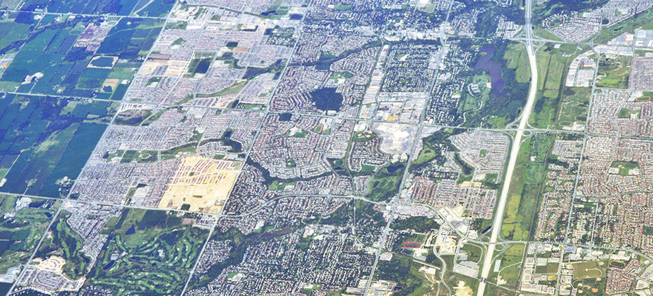 Aerial photo of Markham with subdivisions, streets, highways, industrial areas, natural corridors and surrounding area
